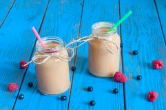 Healthy baby food: apple banana or apricot puree Stock Images