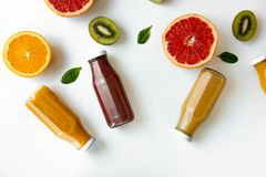 Healthy background with different juices and fruits on white desk. Healthy background with different juices and fruits on white desk stock image