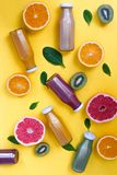 Healthy background with different juices and fruits on yellow desk. Healthy background with different juices and fruits on yellow desk stock photos