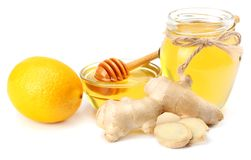 Healthy background. ginger with lemon and honey isolated on white background close up stock image
