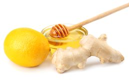 Healthy background. ginger with lemon and honey isolated on white background close up stock photo