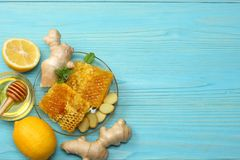 Healthy background. honey, honeycomb, lemon, tea, ginger on blue wooden table. Top view with copy space Stock Photography