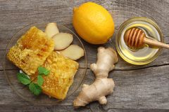 Healthy background. honey, honeycomb, lemon, tea, ginger on old wooden table. Top view with copy space Royalty Free Stock Photos