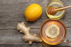 Healthy background. honey, honeycomb, lemon, tea, ginger on old wooden table. Top view with copy space Royalty Free Stock Image