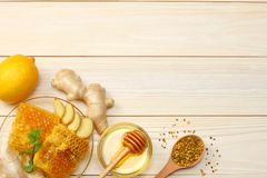Healthy background. honey, honeycomb, lemon, tea, ginger on white wooden table. Top view with copy space Stock Images