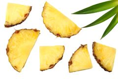 Healthy background. pineapple slices with green leaves isolated on white background top view Royalty Free Stock Photo