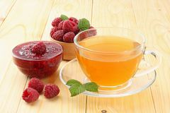 Healthy background. raspberry with raspberry jam and tea on light wooden table Stock Photos