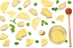Healthy background. sliced ginger, honey and lemon isolated on white background top view royalty free stock photo