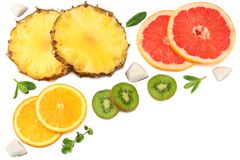 Healthy background. slices of grapefruit, kiwi fruit, orange and pineapple isolated on white background top view Royalty Free Stock Image