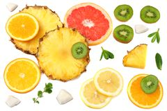 Healthy background. slices of grapefruit, kiwi fruit, orange and pineapple isolated on white background top view Royalty Free Stock Images