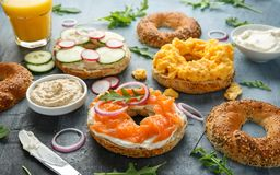 Healthy Bagels breakfast sandwich with salmon, scrambled eggs, vegetables and cream cheese royalty free stock photos