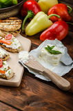 Healthy baguette, spread curd cheese with vegetable and herbs. Variations of peppers Stock Images