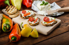 Healthy baguette, spread curd cheese with vegetable and herbs. Variations of peppers Stock Photos