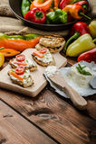 Healthy baguette, spread curd cheese with vegetable and herbs. Variations of peppers Stock Photography