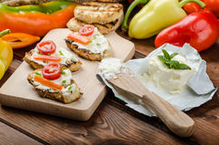 Healthy baguette, spread curd cheese with vegetable and herbs. Variations of peppers Stock Photo