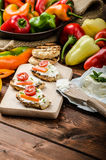 Healthy baguette, spread curd cheese with vegetable and herbs. Variations of peppers Stock Image