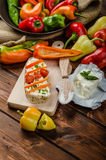 Healthy baguette, spread curd cheese with vegetable and herbs. Variations of peppers royalty free stock images