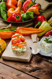 Healthy baguette, spread curd cheese with vegetable and herbs. Variations of peppers Royalty Free Stock Photography