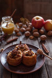 Healthy baked apples stuffed with nuts raisins and cinnamon sticks royalty free stock photography