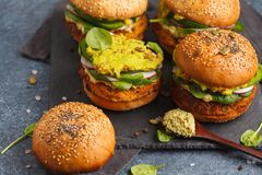 Healthy Baked Sweet Potato Burger With Whole Grain Bun, Guacamole, Vegan Mayonnaise And Vegetables On A Black Slate Board. Royalty Free Stock Image