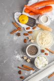 Healthy baking of carrot cake, vegan dessert ingredients: chia,. Coconut butter, almond milk, nuts. Carrot bread, gray background. Healthy vegan food concept stock photos