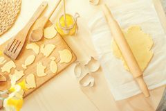Healthy baking, cutting out cookies from raw dough, homemade cookies background. Healthy baking, cutting out cookies from a raw dough, homemade cookies Stock Images