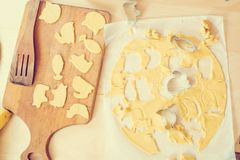 Healthy baking, cutting out cookies from raw dough, homemade cookies background. Healthy baking, cutting out cookies from a raw dough, homemade cookies Royalty Free Stock Image