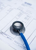 A healthy balance. A stethoscope resting on a bank statement showing a good credit balance Stock Photo