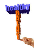 Healthy balance. Written in 3D on an isolated white background, finger balances text Royalty Free Stock Photo