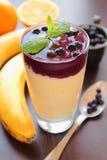 Healthy banana-blueberries smoothie Stock Photos