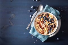 Healthy banana smoothie bowl with blueberry chocolate walnuts royalty free stock photography