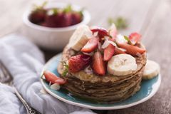 Healthy banana and strawberries pancakes Stock Images