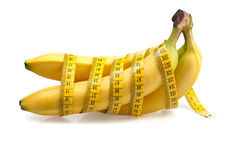 Healthy bananas. Bananas wrapped with yellow measuring tape Royalty Free Stock Photography