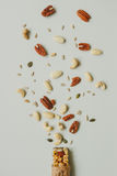 Healthy bar with nuts and seeds on the gray background, top view Stock Photography