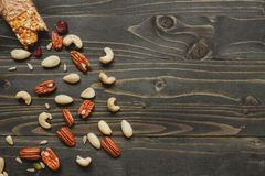 Healthy bar with nuts and seeds on the wooden background, top view. Copy space Stock Photo