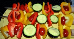 Prepared vegan skewers with zucchini, sweet peppers and tomatoes. Healthy barbecue alternate with vegan skewers with zucchini, sweet peppers and tomatoes Royalty Free Stock Photos