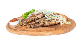 Healthy barbecued lean cubed pork kebabs served with a corn tortilla and fresh lettuce and tomato salad Stock Photo