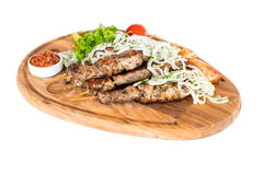 Free Healthy Barbecued Lean Cubed Pork Kebabs Served With A Corn Tortilla And Fresh Lettuce And Tomato Salad Royalty Free Stock Image - 44372726