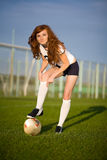 Healthy beautiful girl with freckles on soccer fie Royalty Free Stock Photos