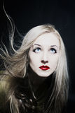 Healthy beautiful long hair in motion created by wind, fashion l Stock Photography