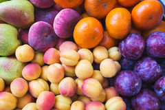 Healthy, beautiful and tasty food is fruit. Vitamins and bright summer colors. The harvest of fresh fruits is a top view and a soft focus Royalty Free Stock Images
