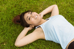 Healthy and beautiful woman lying on grass in park Royalty Free Stock Photos