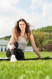 Healthy beautiful woman practicing pilates in the nature Stock Photo