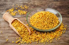 Healthy bee pollen. Raw organic bee pollen over wooden board Royalty Free Stock Photography