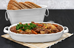 Healthy beef stew in an oval white casserole. Royalty Free Stock Photo