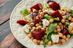 Healthy Beet Salad with chickpeas, pistachios nuts, feta cheese royalty free stock images