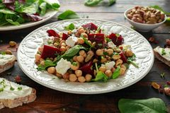 Healthy Beet Salad with chickpeas, pistachios nuts, feta and melted cheese toast.  stock images