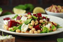 Healthy Beet Salad with chickpeas, pistachios nuts, feta and melted cheese toast.  royalty free stock image