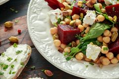 Healthy Beet Salad with chickpeas, pistachios nuts, feta and melted cheese toast royalty free stock images