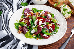 Healthy Beet Salad with fresh sweet baby spinach, kale lettuce, nuts, feta cheese and toast  melted Royalty Free Stock Photo